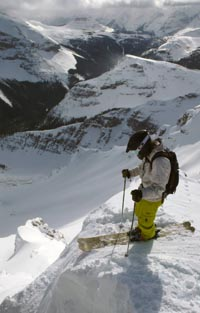 Skier perched on Delirium Dive, Sunchine,Alberta